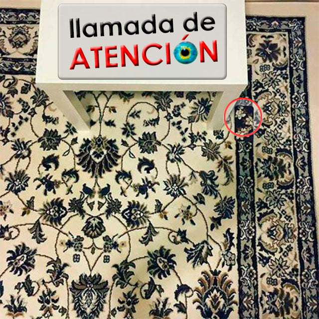 teléfono móvil sobre una alfombra